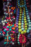 Beads of round colorful stones lie on the counter of souvenir sh Royalty Free Stock Photography