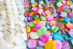 Beads of round colorful stones lie on the counter Royalty Free Stock Photo
