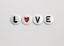 Beads saying. Beads spelling the word Love Royalty Free Stock Photo