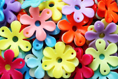Beads in the shape of flowers closeup. Stock Images