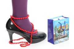 Beads and shoes Stock Photography