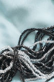 Beads on silk Royalty Free Stock Image