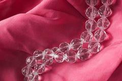 Beads on silk Royalty Free Stock Photo