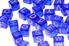Beads Spell out Love. Blue beads with white writing scattered out and spell love Stock Photos