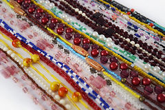 Beads strings background. Different colorful beads strings forming background Stock Images