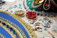 Beads and trimmings to make a russian folk tiara. Beads and trimmings to make a  multicolored russian folk tiara Stock Image