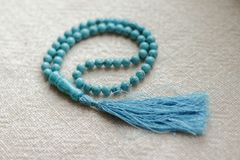 Beads of turquoise 108 items. 108 beads of turquoise for mantras and meditation Royalty Free Stock Images