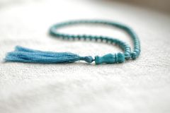 Beads of turquoise 108 items. 108 beads of turquoise for mantras and meditation Royalty Free Stock Photo