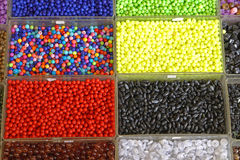 Beads. Various colorful plastic beads in trays Stock Photography