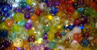 Beads through water drops. Stock Image