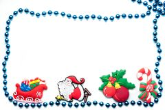 Beads on a white background with christmas toys. Blue beads on a white background with Christmas toys Stock Photo