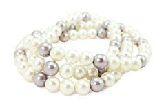 Beads of white and black pearls Stock Photo