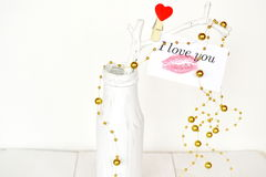 Beads, white thread, a bottle, the words 'I love you'. Background of Valentine's day Stock Photo