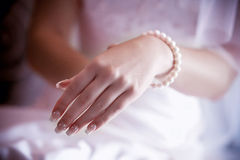 Beads in woman hand Royalty Free Stock Image