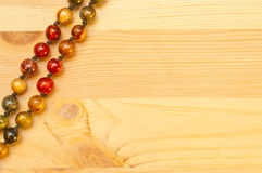 Beads on a wooden background Stock Photo