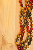 Beads on a wooden background Stock Image
