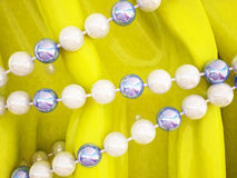 Beads on a yellow cloth, Stock Image