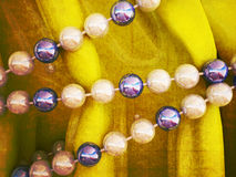 Beads on a yellow cloth, Stock Photos