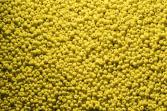 Beads of yellow colour close up macro photo. Beads of yellow colour. background Stock Images