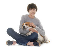 Beagle and teenager. Adult beagle and teenager in front of white background Stock Images