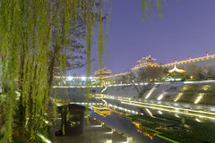 Beaitiful moat with willow of the xian circumvallation night sight. Xian ancient city, shaanxi province, china. xian wall is chinese largest existing and most royalty free stock photography