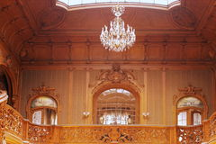 Beaitiful rich interior of palace with wood-carving. Beatiful rich interior with balcony , big windows and wall with wood-carving of palace of sience in Lviv Stock Photo