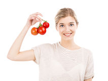 Beaitiful woman holding red tomatos Stock Image
