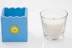 Beaker and candle Stock Image