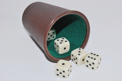 Beaker and dices in white background. Luck game in casino. Beaker and dices on white background. Gambling stock photo