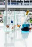 Beaker and fish bowl. royalty free stock images