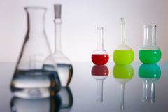 Beakers. Beacons in the backlight, reflection, colored chemical