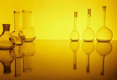 Beakers. Beacons in the backlight, reflection, yellow background