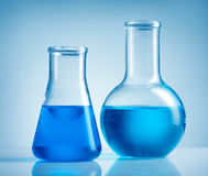Beakers and blue liquid Stock Photo