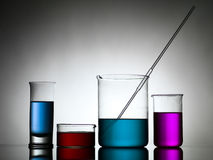 Beakers with dropper and colored liquid substances Stock Image