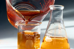 BEakers & flasks chemistry lab. Mixing liquids in a sterile environmnt at a chemistry lab Stock Photos