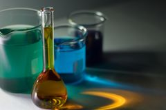 Beakers. Glass beakers and flasks on lab table Royalty Free Stock Photos
