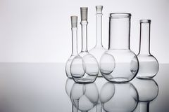Beakers. Many beakers in the backlight, reflection, blue background