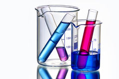 Beakers with Test Tubes Filled with Chemicals Royalty Free Stock Photography