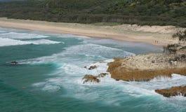 Beaking waves. The surf crashing onto the beach in Australia royalty free stock image