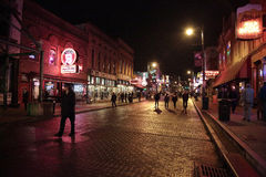 Beale Street. Memphis, TN, USA - Jan. 23, 2015 - Pedestrians wander historic, neon-lit Beale Street during the International Blues Challenge on Jan. 23, 2015 Royalty Free Stock Image