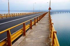 Beam Bridge over a Lake Stock Photography
