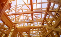 Free Beam Close-up Building With Under Construction Wooden House With Timber Framing Stock Photography - 167924052