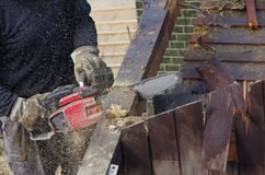 Beam cut by a chainsaw Stock Photos