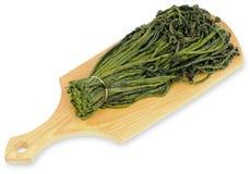Beam fern on a cutting board Stock Image