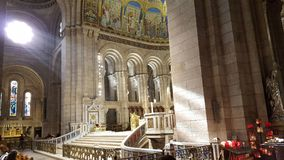 Beam of light in church. Beam of light in sacre coeur in paris. God watch over us Stock Photography