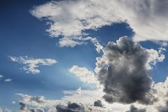 Beam of light and the clouds. Beam of light and the dark clouds Royalty Free Stock Photography