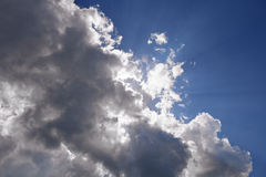 A beam of light through the clouds. Ray of light Royalty Free Stock Photos