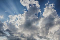 Beam of light and the clouds. Beam of light and the dark clouds Stock Image