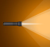 Beam of light from  flashlight. Black metal . Royalty Free Stock Photo