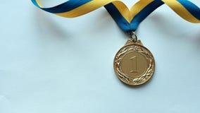 Beam of light moving across a winners medal
